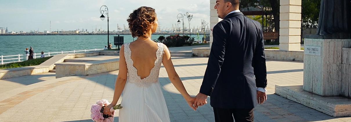 Bride and groom holding hands, wedding day in Constanta, Black Sea coast